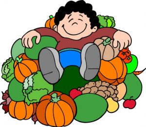 PIck-Your-Own picker relaxing on pile of fresh produce
