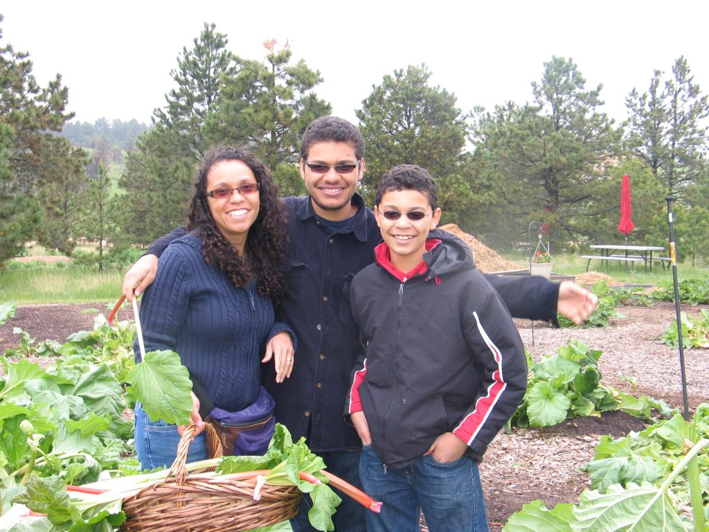 family picking rhubarb at the Rhubarb Harvest Festival